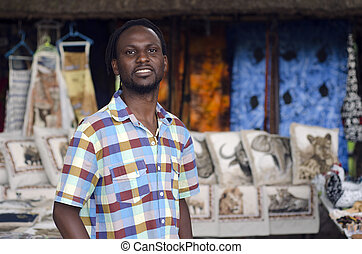 African small business curio salesman selling ethnic items...