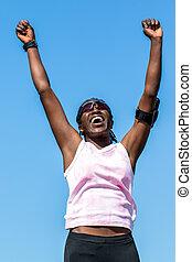 African sports woman showing winning attitude.