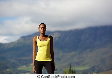 African sports woman standing outdoors in nature