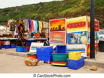 CAPETOWN, SOUTH AFRICA - DECEMBER 29:A street market of African crafts, where you can buy typical pictures and dresses on December 29, 2007 at Capetown province, South Africa.
