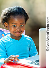 African student doing homework.