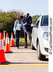 african student driver and male instructor pre test inspection