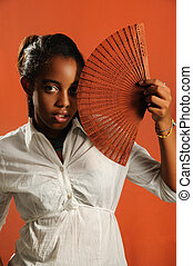African teen girl with fan