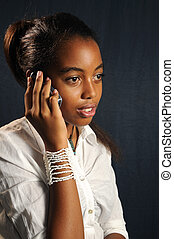 African teen with cell phone