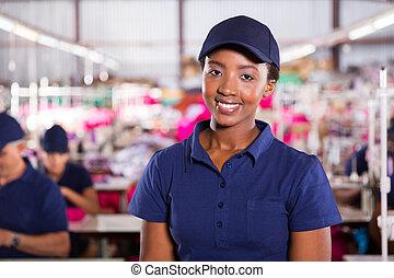african textile worker closeup portrait