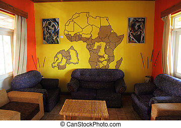 African Themed Living Room with Mural - A small living room...