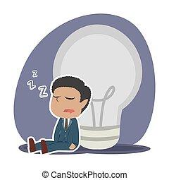 African tired businessman sleeping beside dim bulb