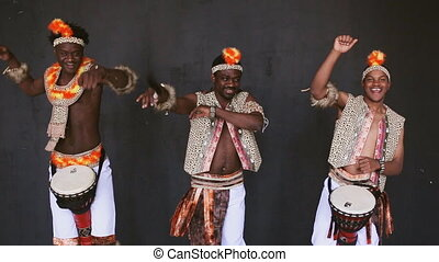 African tribe dancing on black background