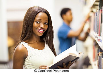african university student reading book