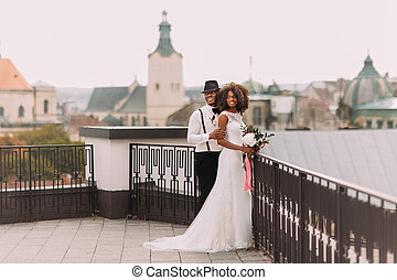 African wedding couple on the rooftop. Amazing european Lviv...