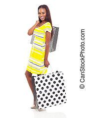 african woman carrying shopping bags - beautiful african...