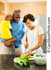 african woman chopping vegetables in the kitchen