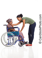 african woman comforting disabled senior grandmother