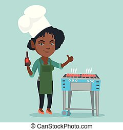 African woman cooking steak on the barbecue.