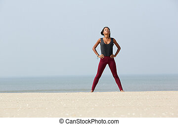 African woman doing yoga breathing exercise