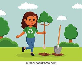 African woman environmental activist planting tree