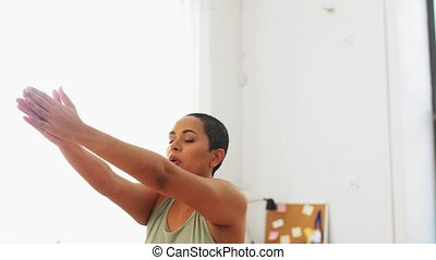 african woman exercising and jumping at home - sport, ...