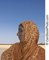 African woman, headscarf, glasses