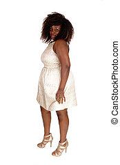 African woman in beige dress.