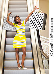 african woman in shopping mall