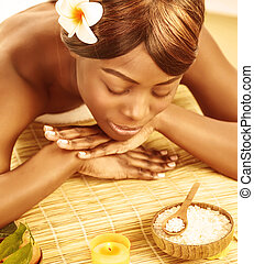 African woman in spa salon