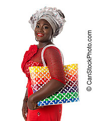 African woman in traditional clothing with tote bag.Isolated