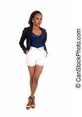 African woman in white shorts.
