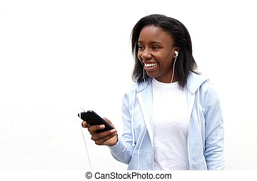 African woman listening music on smartphone