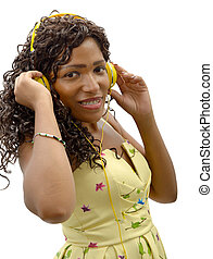 African woman listening to music on white