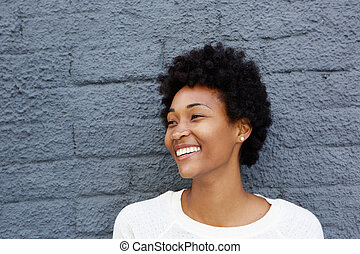 African woman looking away and smiling