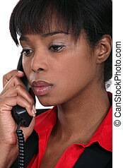 African woman making telephone call