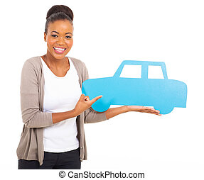 african woman pointing car symbol
