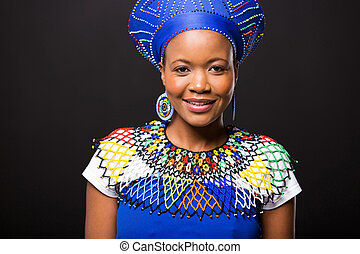 african woman portrait on black background