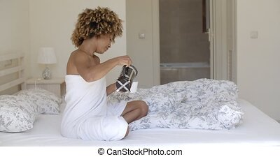 African woman pouring freshly brewed coffee