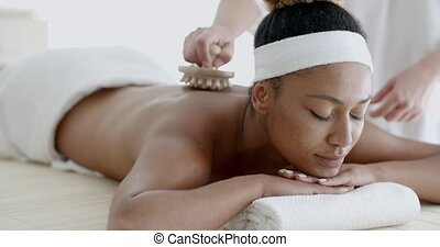 African Woman Receiving Back Massage - Closeup of happy...