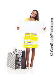 african woman shopping and holding blank white board