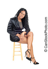 African woman sitting on chair.