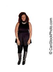 African woman standing business attire.