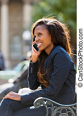 african woman talking on cell phone
