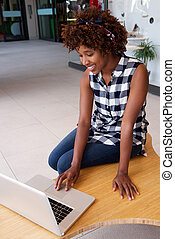 african woman using laptop computer