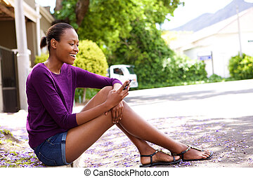 African woman using mobile phone