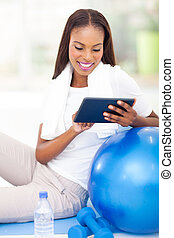 african woman using tablet pc