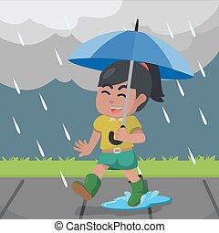 African Woman walking in the rain - Woman walking in the...