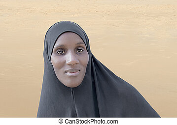 African woman wearing a black veil
