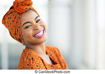 african woman wearing traditional attire - happy african...