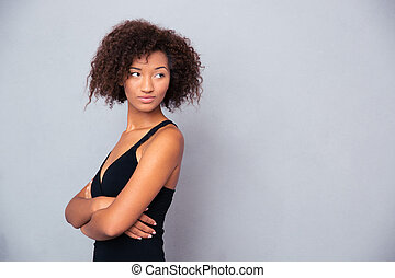 African woman with arms folded