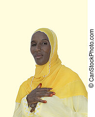African woman, yellow cotton veil