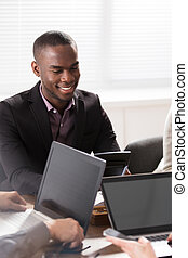 African Young Man In Office