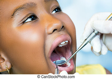 African youngster at dental checkup.