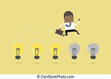 africano, homem negócios, salto, ligado, luz, bulbs.
